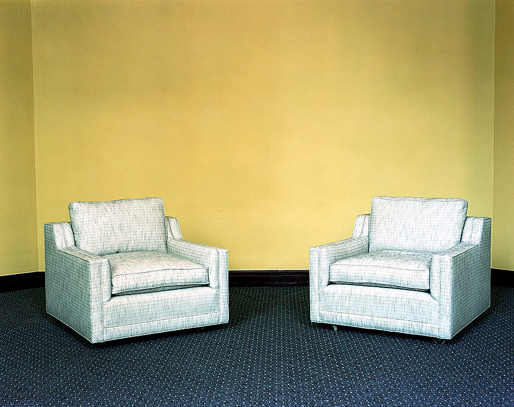 photo displayed in the installation [sofas and yellow wall]
