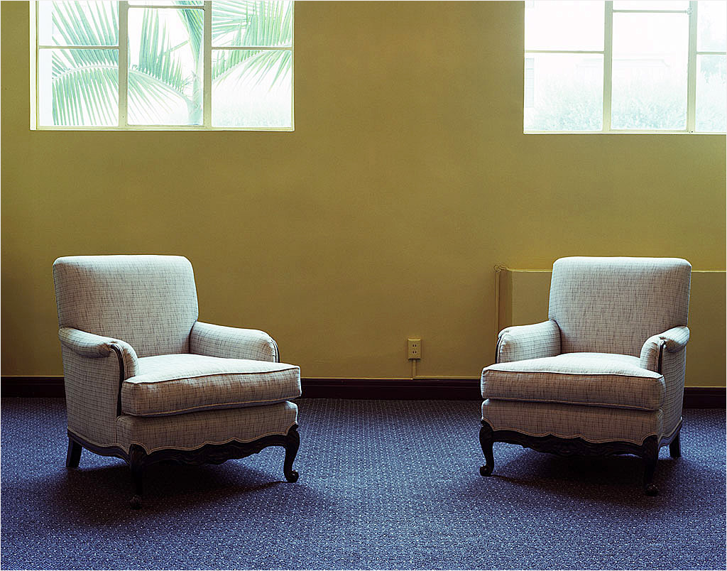photo displayed in the installation [sofas with legs and yellow wall]