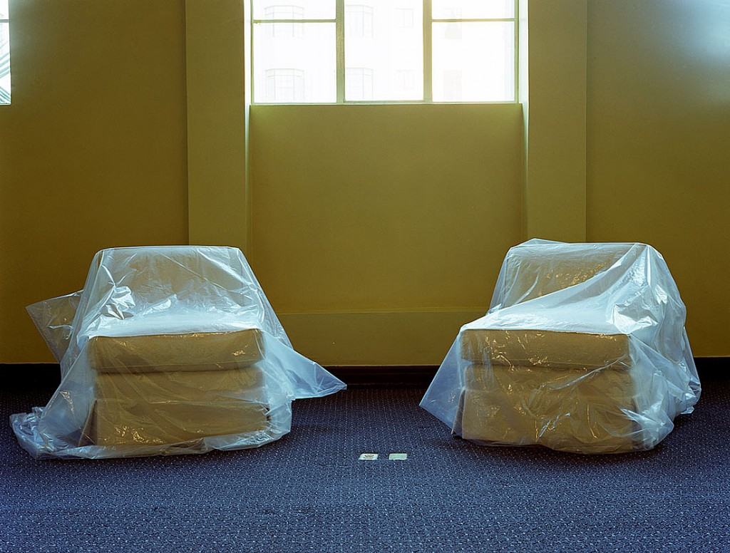 photo displayed in the installation [sofas covered with plastic]